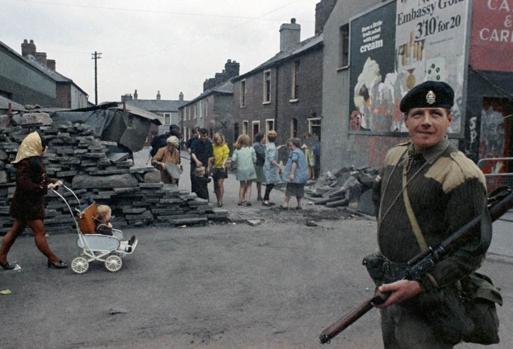 An armed British soldier in Belfast, Northern Ireland during disorders in September 1969. In the background are local people. (AP Photo/Royle) Ref #: PA.11408246  Date: 14/09/1969