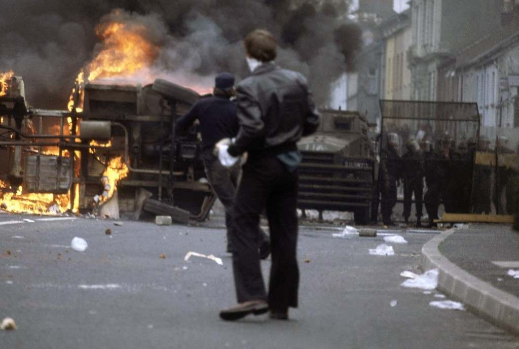 A man hurls missiles at an overturned bread delivery van that was set afire in the Bogside district of Londonderry, Northern Ireland in August 1979. Fresh disorders in the troubled province marked the tenth anniversary of British army intervention in the area. (AP Photo/Peter Kemp) Ref #: PA.11408251