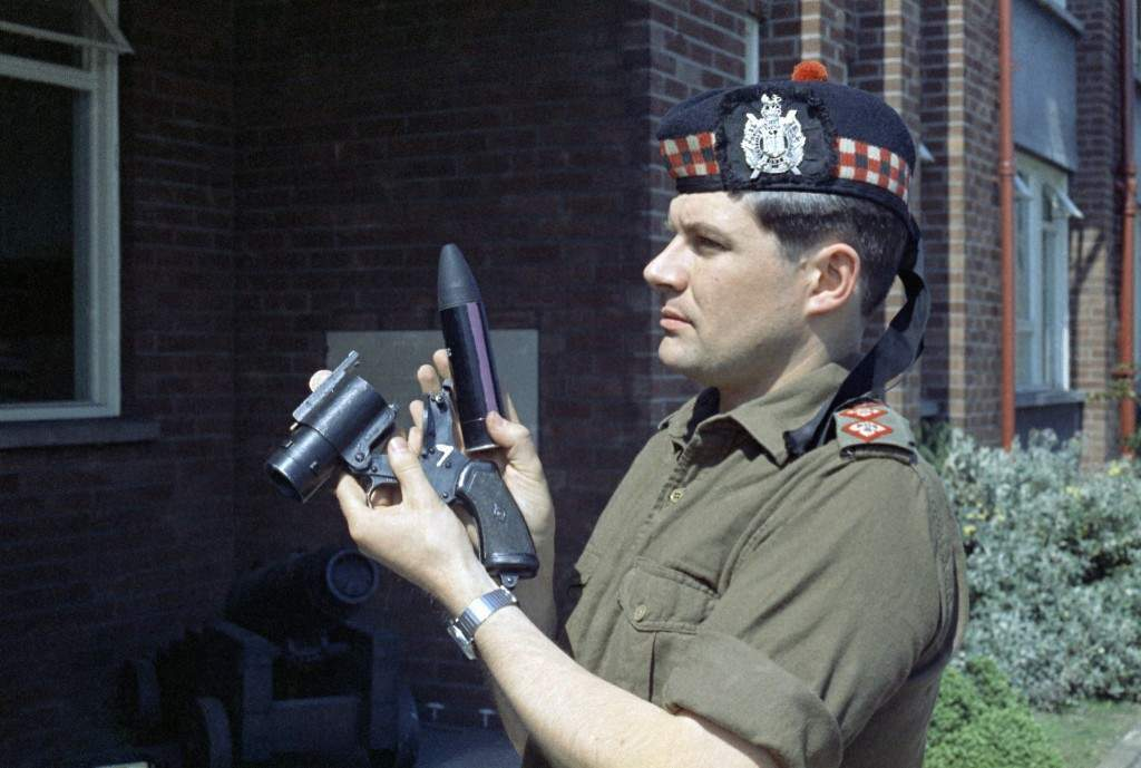 Captain Young of the King's Own Scottish Borderers holds the British Army's new anti riot weapon, the rubber bullet, which was used recently in the new Lodge Road area of Belfast, Northern Ireland during riots in 1970. (AP Photo/Peter Kemp) Ref #: PA.11426323
