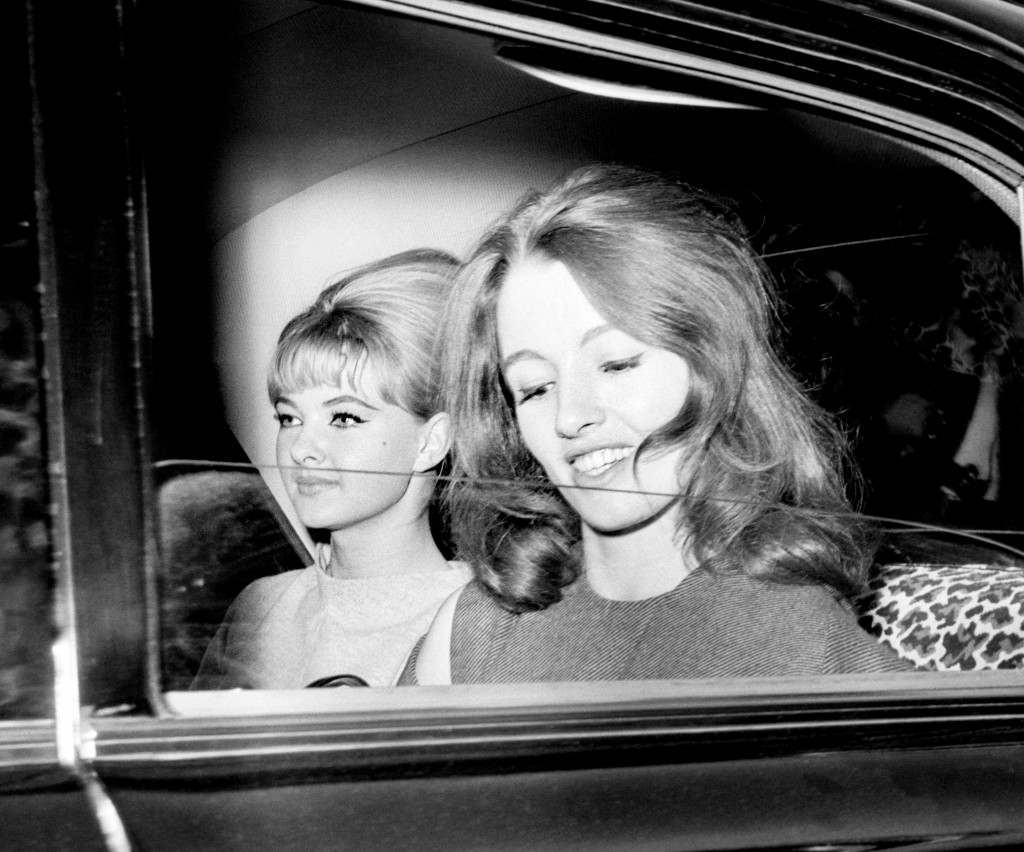 Christine Keeler, right, and Mandy Rice-Davies leaving the Old Bailey after the conclusion of the fist day's hearing of the trial at the Old Bailey in which Dr. Stephen Ward, 50 year old osteopath faces vice charges. Ref #: PA.1146021  Date: 22/07/1963