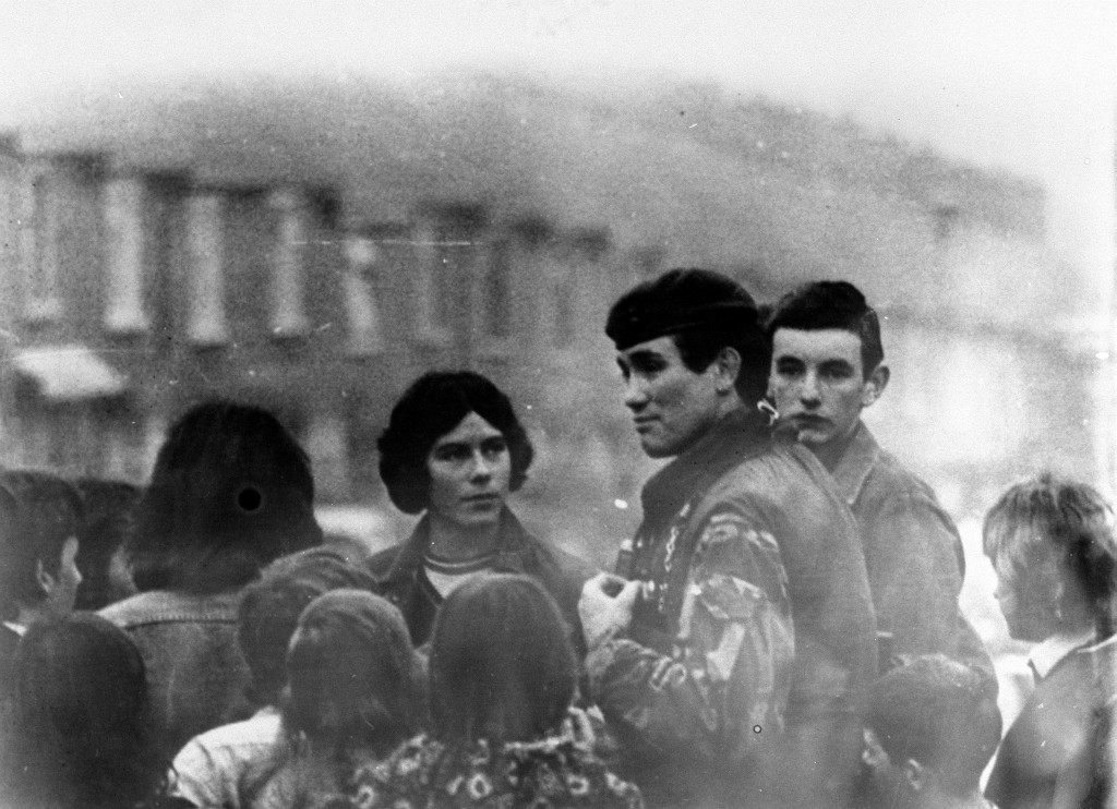 GRENADIER GUARDS CAPTAIN ROBERT NAIRAC TALKING TO CHILDREN IN THE ARDOYNE AREA OF BELFAST IN FEBRUARY 1977. NAIRAC WAS EXECUTED BY THE FIRST BATTALION OF THE IRA AFTER DISAPPEARING IN DRUMINTREE.