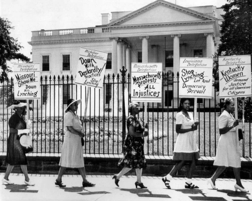 Pickets, representing the National Association of Colored Women, march at the White House, Washington, July 30, 1946, carrying posters protesting lynching. Placards bear names of Missouri, Michigan, Massachusetts, Louisiana and Kentucky delegations. (AP Photo)