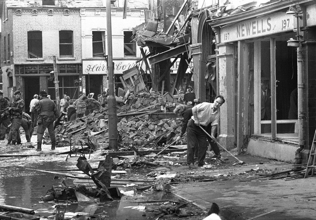 Soldiers search among the wreckage of a building in the Shankhill Road area of Belfast, Northern Ireland on Thursday, August 17, 1972 after a bomb had destroyed a bar and other nearby buildings. (AP Photo/Heinz Ducklau) Ref #: PA.11867666 Date: 17/08/1972
