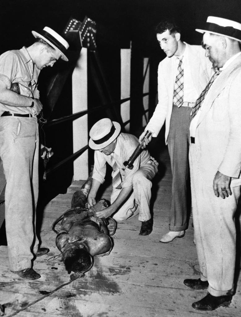 Weary searchers found the bullet-riddled body of Albert Gooden, 35-year-old African American, Tipton County's first lynch victim since the Civil War near Covington, Tennessee on August 17, 1937. Gooden was seized from Sheriff W.J. Vaughan the night before while the officer was en route from Memphis, where Gooden was held for safekeeping, to Covington, where he was to face a charge a slaying an officer. (AP Photo)