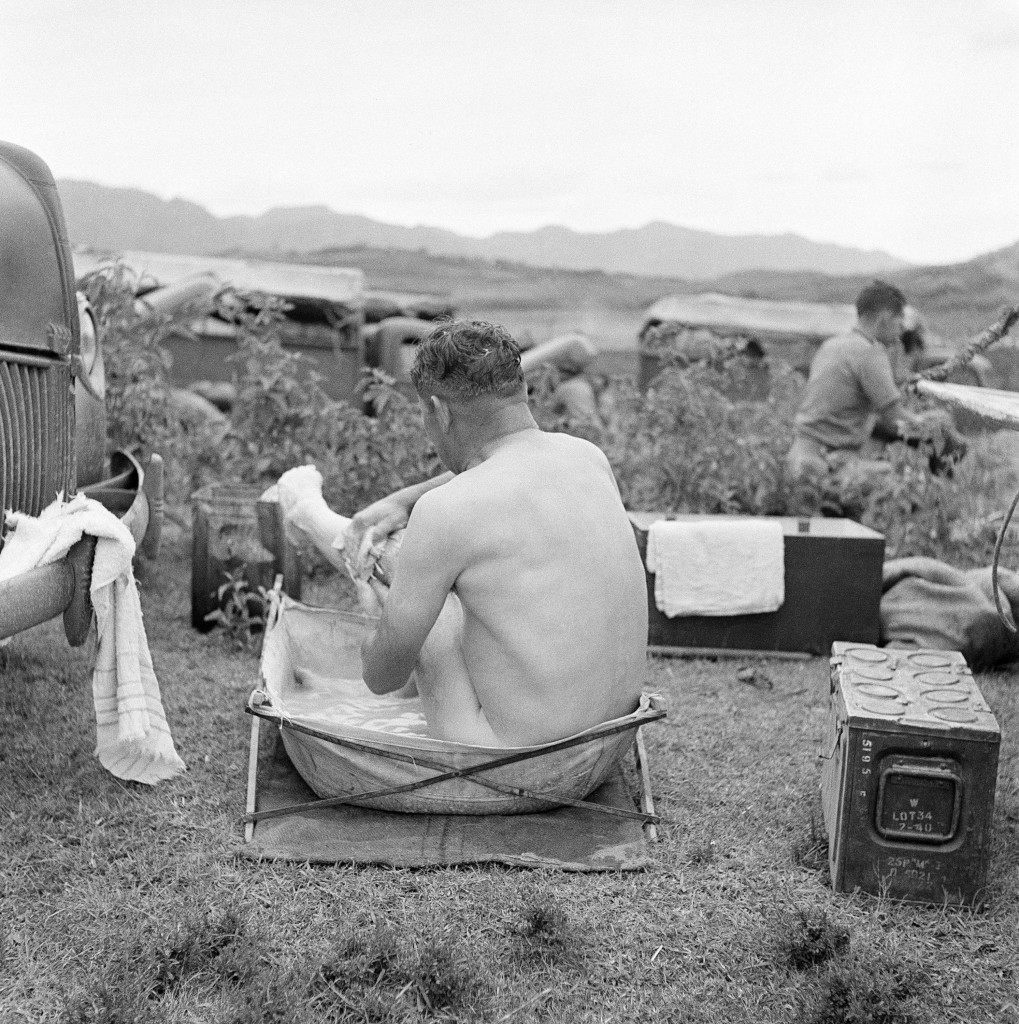 A South African captain in the British convoy which transported Ethiopian prisoners of war back to their homes in Abbyssinia enjoys a bath in a portable tub after a day's ride over dust-roads on May 14, 1942. The portable tubs are part of an officer's equipment. (AP Photo)