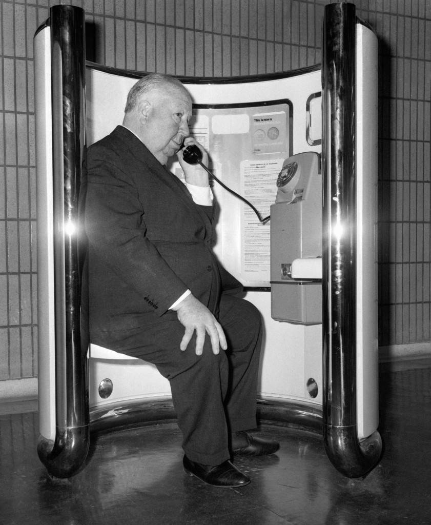 "Film director Alfred Hitchcock makes a telephone call at Heathrow Airport, before flying to Los Angeles, after making his film ""Frenzy"". Ref #: PA.1283193  Date: 23/10/1971"