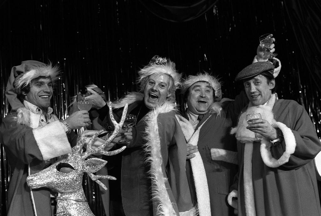 Female impersonator Danny La Rue (2nd L) pours out champagne at the Talk of the Town Restaurant, London. Fellow entertainers are Freddie Starr (L), Colin Crompton (R), and Bernard Manning. Ref #: PA.1323897  Date: 11/12/1974