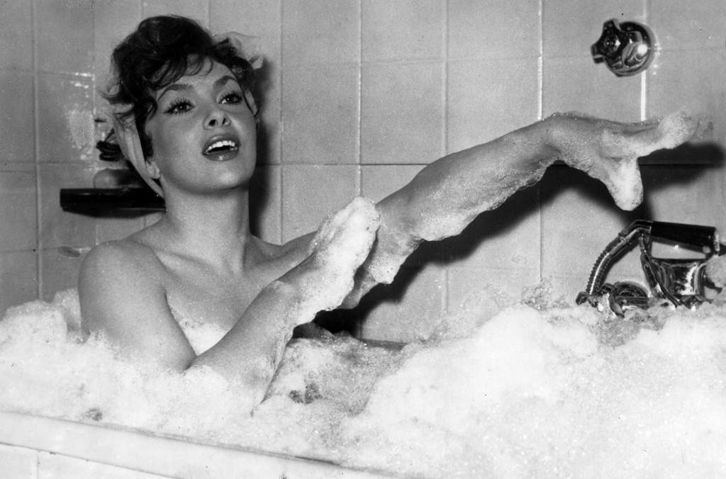 """In this Dec. 5, 1957 file photo Italian actress Gina Lollobrigida takes a bubble bath in a scene of her film called """"Anna from Brooklyn"""", shot at Rome's Cinecitta studios."""