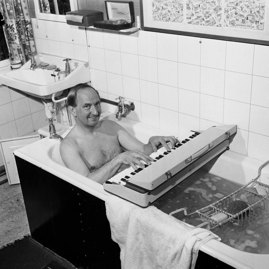 Concert pianist, Joseph Cooper, who is to play at this years Bath Festival is in constant rehearsal. He is pictured using a dummy key board even while taking a bath at his home in Surrey. Picture date: 11th May 1964.