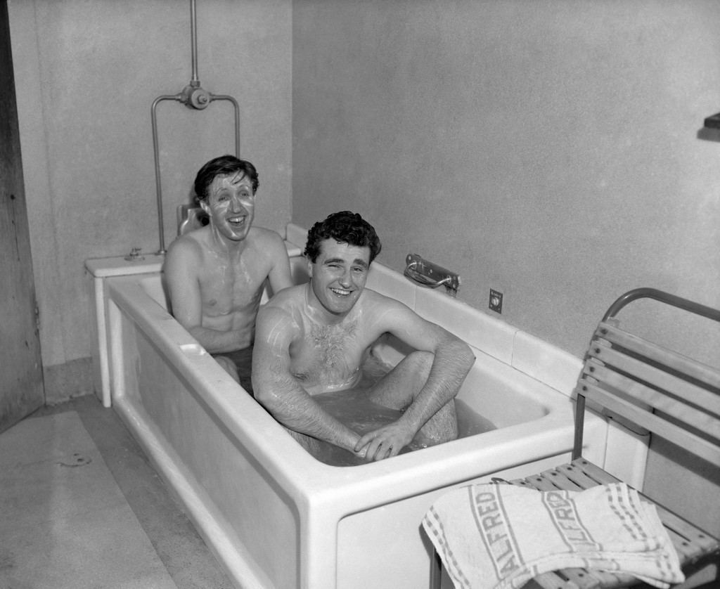 West Ham fullbacks John Bond (left) and Noel Cantwell taking a bath in sea water as they prepare for an FA Cup tie against Blackburn at Upton Park. Ref #: PA.15076368  Date: 14/02/1956