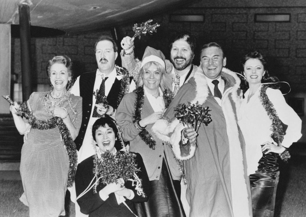 BBC TV stars in festive mood in London for the launch of the corporation's Christmas package of programmes. Over the holiday season viewers will see, back row, from left, 'Allo 'Allo stars Carmen Silvera, Gordon Kaye and Vicki Michelle. Front row, from left, Hi De Hi's Ruth Madoc, EastEnder's Wendy Richard, Dave Lee Travis and Father Christmas attired Bob Monkhouse. Ref #: PA.15141588  Date: 03/12/1986
