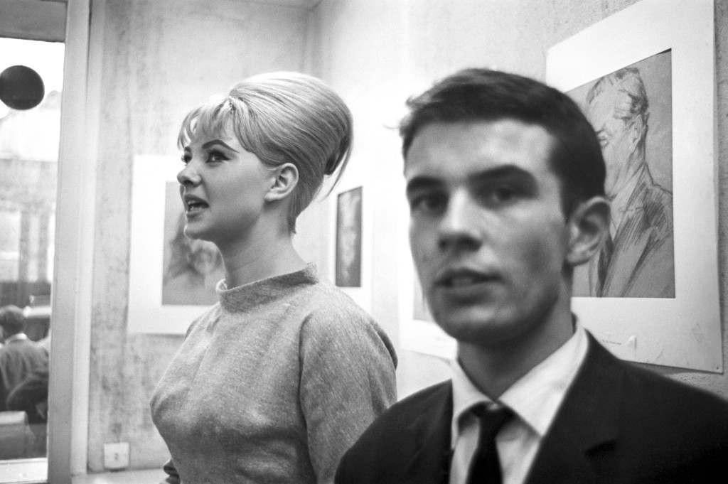 Mandy Rice-Davies and John Andrew Hamilton Marshall at a preview of a portrait exhibition by artist and osteopath Dr Stephen Ward - who became a central figure in the Profumo Affair. Mr Marshall was treated as a hostile witness after a dispute over evidence during Dr Ward's hearing. Ref #: PA.15717651  Date: 22/07/1963