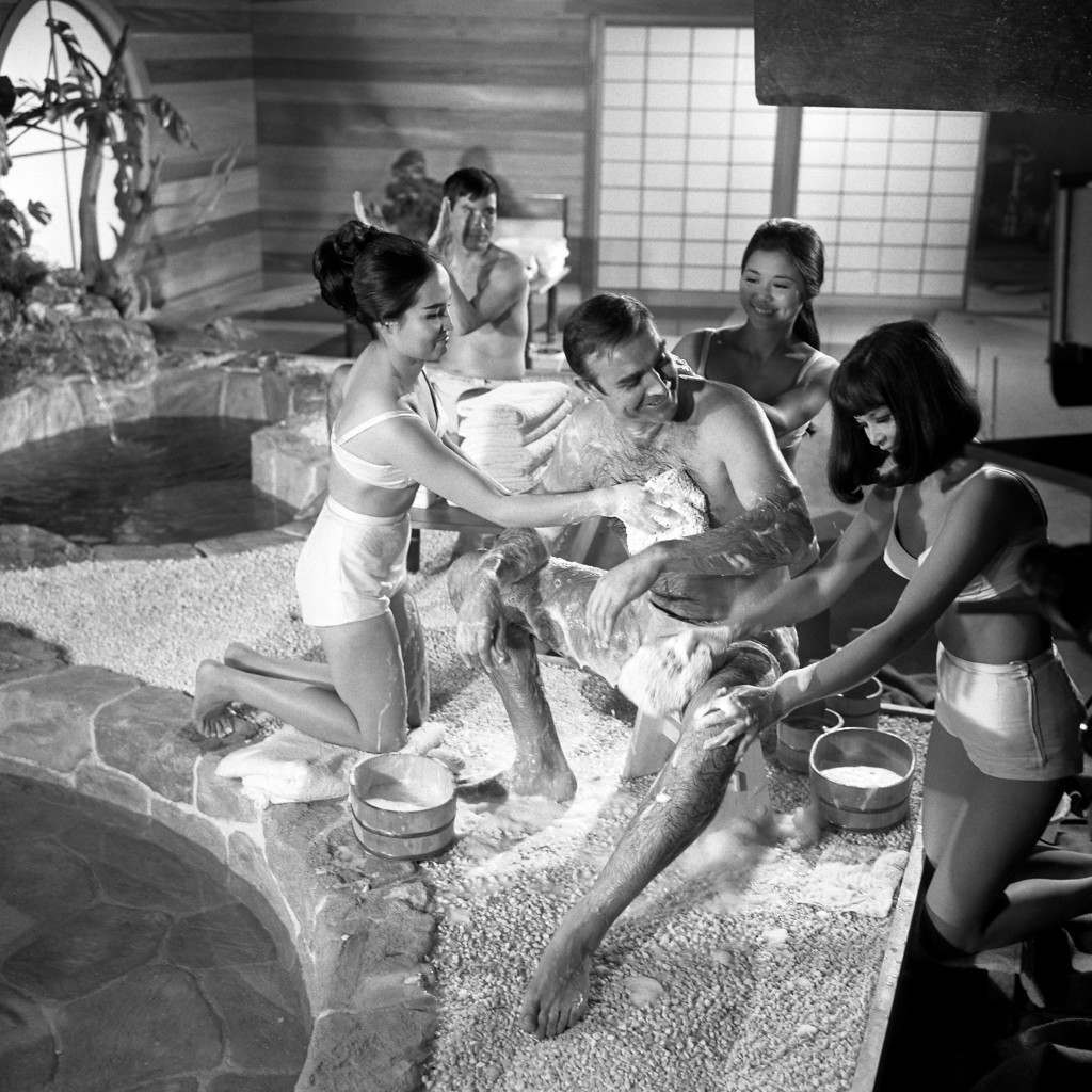 """Sean Connery films a scene for """"You Only Live Twice"""" at Pinewood Studios in Buckinghamshire. James Bond, who has sampled most other of life's good things, savours an Oriental delight-a Japanese bath for his new film """"You Only Live Twice"""".  Ref #: PA.18892152  Date: 26/09/1966"""