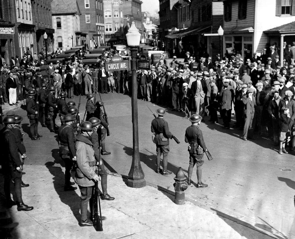 State Troopers keep a crowd in check in Salisbury, Md., Nov. 28, 1933. The troopers were sent by Gov. Albert Ritchie to arrest suspects in the lynching of George Armwood in nearby Princess Anne, Md., last month. They were threatened by the crowds and used tear gas to repulse them. (AP Photo)