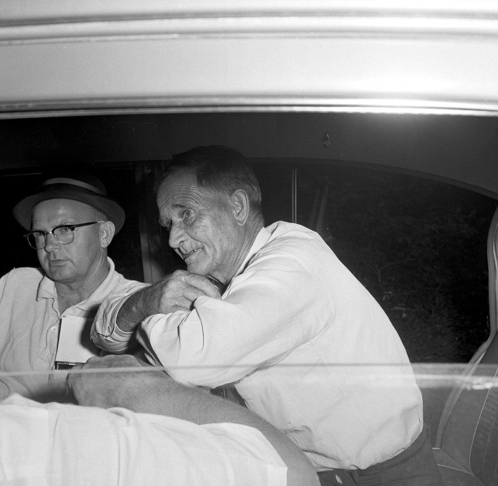 John Reyer, right, a 63-year-old local farmer,sits in the rear of an FBI car telling agents how he witnessed the abduction of Mack Charles Parker from his jail cell, in Poplarville, Miss., April 26, 1959. Reyer told them he saw four masked men throw an African-American man into the back seat of a car and drive off. Reyer had been visiting the hospital across the street. Parker was being held on the charge of raping a white woman. The trial was scheduled to start in two days. (AP Photo/Richard Tolbe