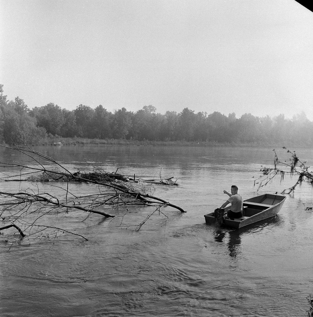 The clog of debris in the Pearl River where the body of Mack Charles Parker was discovered, is pointed out by Al Wheat, 39-year-old fisherman, near Poplarville, Miss., May 5, 1959. Wheat, who aided the recovery of the body with his small boat, points to the outermost clump, at left. Swampy terrain made recovery by boat necessary. Parker's body was found about two miles south of a bridge connecting the highway between Bogalusa, La., and Poplarville. It was on the Mississippi side of the river which separates the states about 20 mile west of here. (AP Photo/Richard Tolbert)
