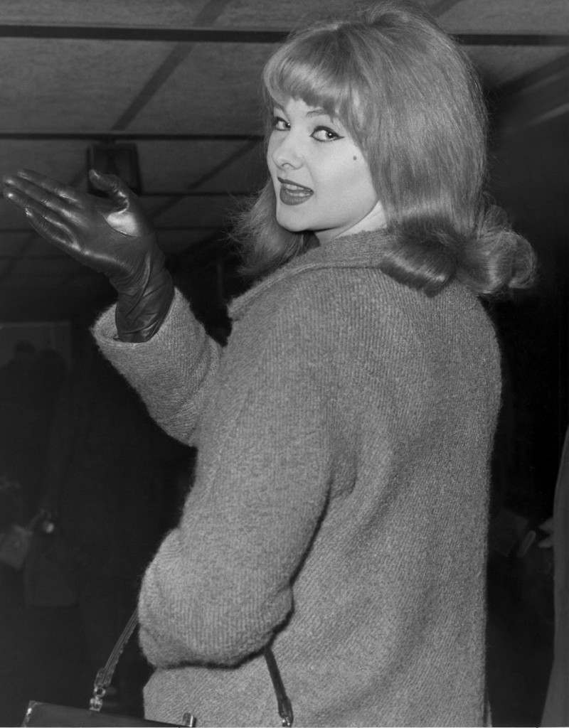 In this Jan. 7, 1964 file photo, Mandy Rice-Davies waves goodbye at London Airport as she leaves for Munich for a singing engagement.