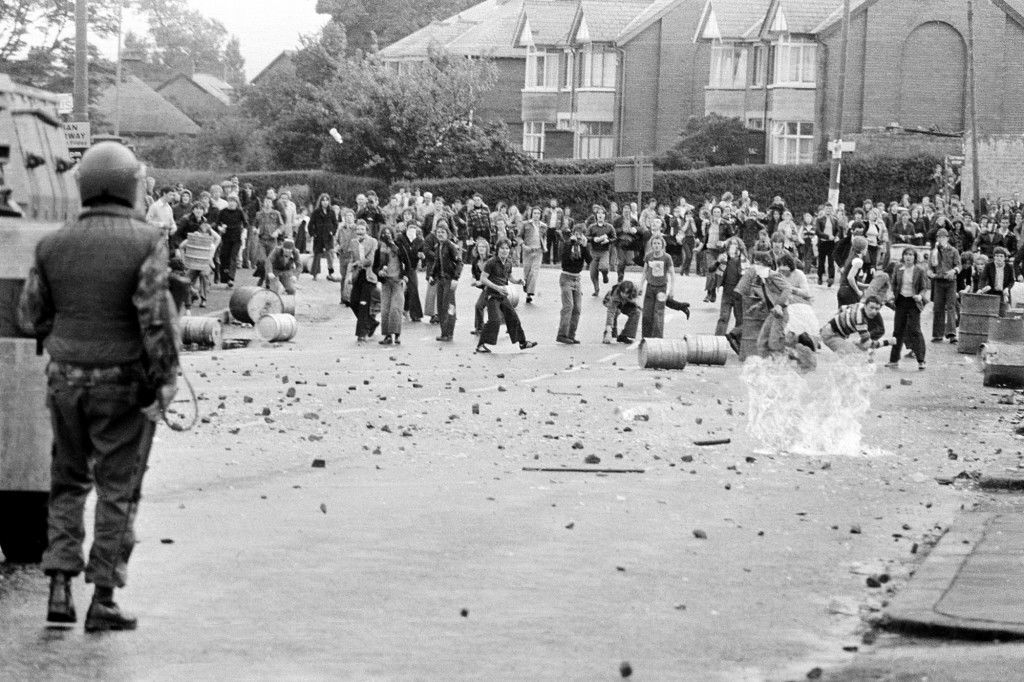 Catholic youths throw stones and gasoline bombs at British troops, Aug.12,1979. Rioting broke out after the British troops appeared at an afternnoon rally in Belfast, Northern Ireland. (AP Photo/Peter Kemp) Ref #: PA.2492369