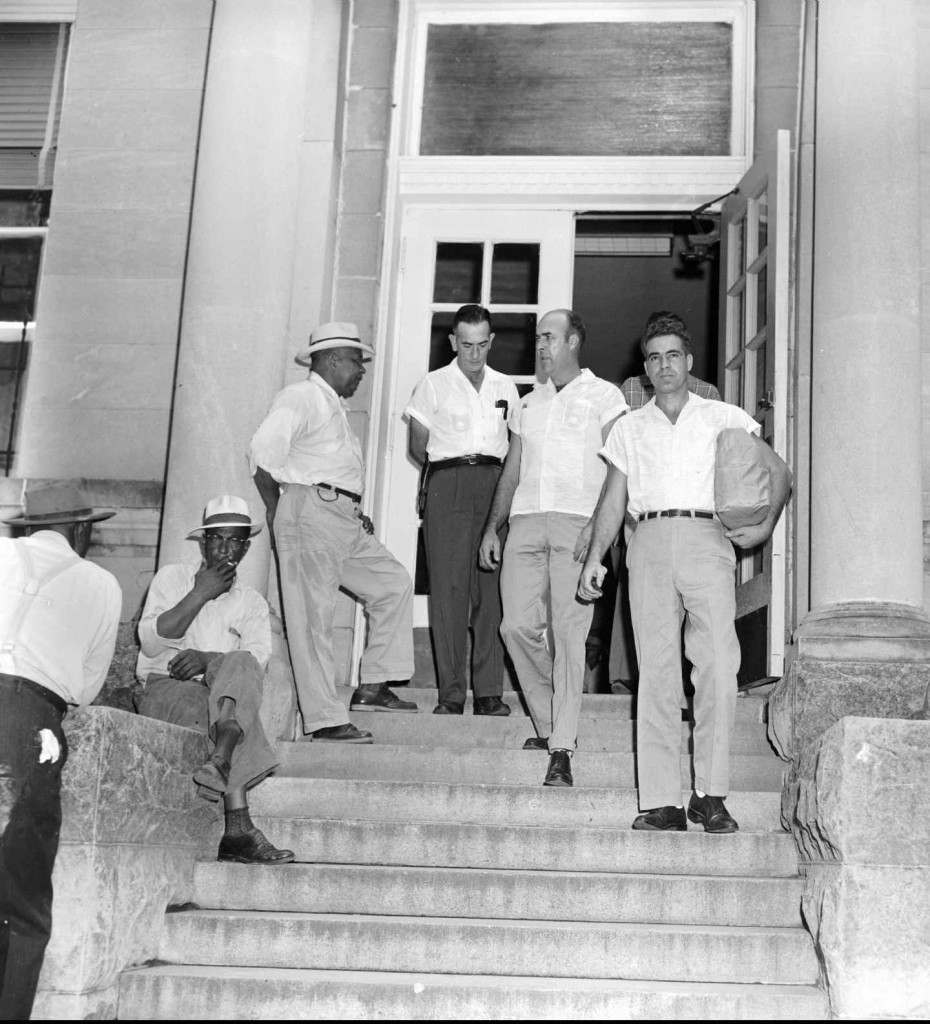 Roy Bryant, right, and his half-brother, J. W. Milam, second from right, walk down the steps of the Leflore County Courthouse in Greenwood, Miss., on Sept. 30, 1955, after being freed on bond in the kidnapping and murder of Emmett Till. Bryant and Milam eventually were acquitted of murdering the 14-year-old black youth in a trial which drew international attention that fall. (AP Photo)