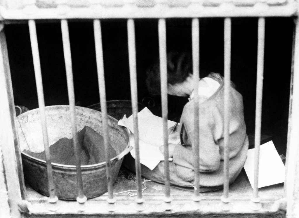 Constance Markiewicz, later known as Mrs Gore-Booth, in a prison cell in Dublin. The Countess was an Irish Sinn Féin and Fianna Fáil politician, revolutionary nationalist and suffragette. She was the first woman elected to the British House of Commons, though she did not take her seat.An active participant in the 1916 Easter Dublin Uprising she is here seen through a cellar window in Liberty hall after her surrender to the British Army. Ref #: PA.2920912