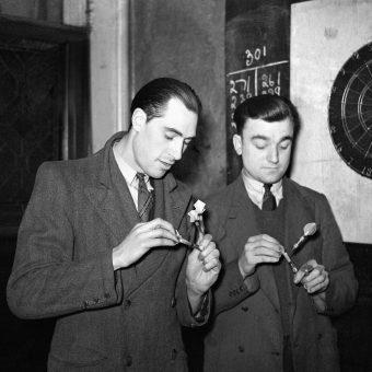 Two Men Play Darts For A Pint Of Beer In A 1930 London Pub