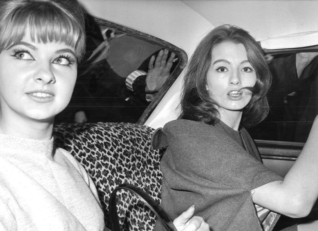 Christine Keeler, right, and Marylin ( Mandy ) Rice-Davies, left, two of the principal witnesses in the vice charges case against osteopath Dr. Stephen Ward, share a car as they drive through London, today, July 22, 1963, after attending the first day of Ward's trial.