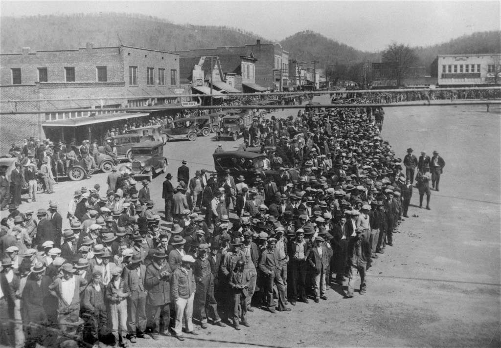 Here is shown a part of the crowd of 10,000 persons who jammed the courthouse square in the little town of Scottsboro, Alabama, April 6, 1933, on the opening of the trials of nine black youths accused of attacking two white girls near Sevenson, Ala., March 24, 1931. National Guardsmen with fixed bayonets patrolled the courthouse grounds, and women and minors were barred from the courtroom. The state asked for the death penalty for the first two defendants to be placed on trial. The other seven will be tried later. The nine were identified by the two girls as the ones who boarded the freight car in which they and seven white youths were riding, forced five of the white youths from the train, knocked the other two unconscious and attacked the girls.