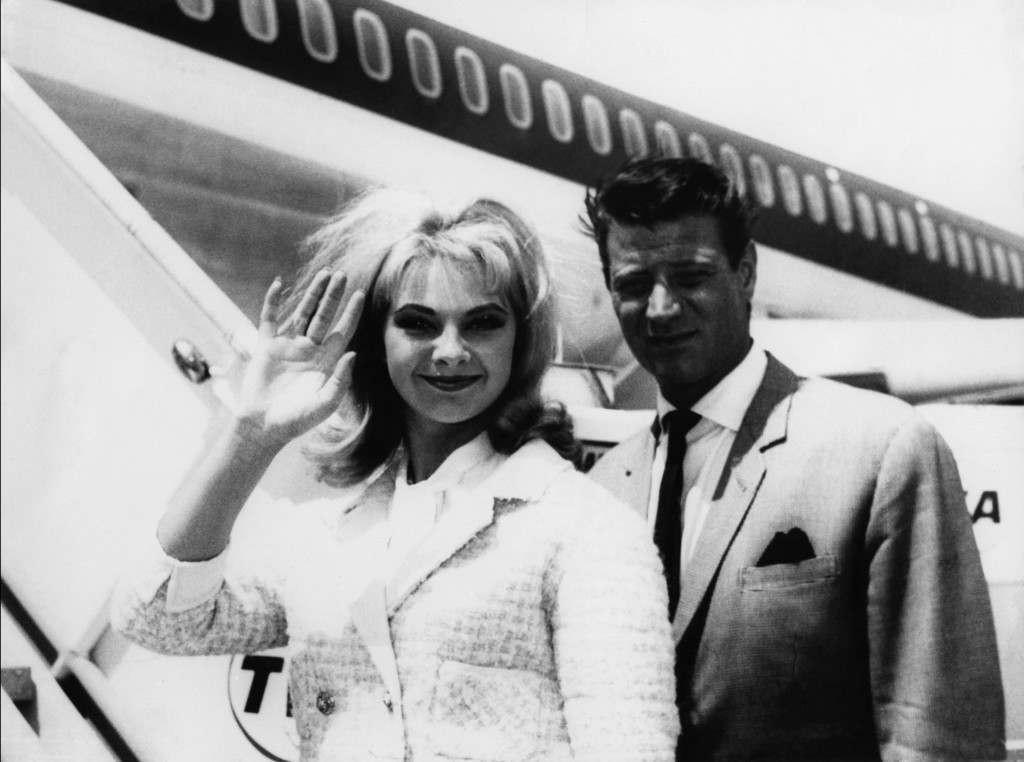 (L-R) Mandy Rice-Davies leaves Rome airport with her friend Pierre Cervello for a holiday in Spain Mandy Rice-Davies is now a professional singer and caberet artist Ref #: PA.4454884  Date: 28/07/1964