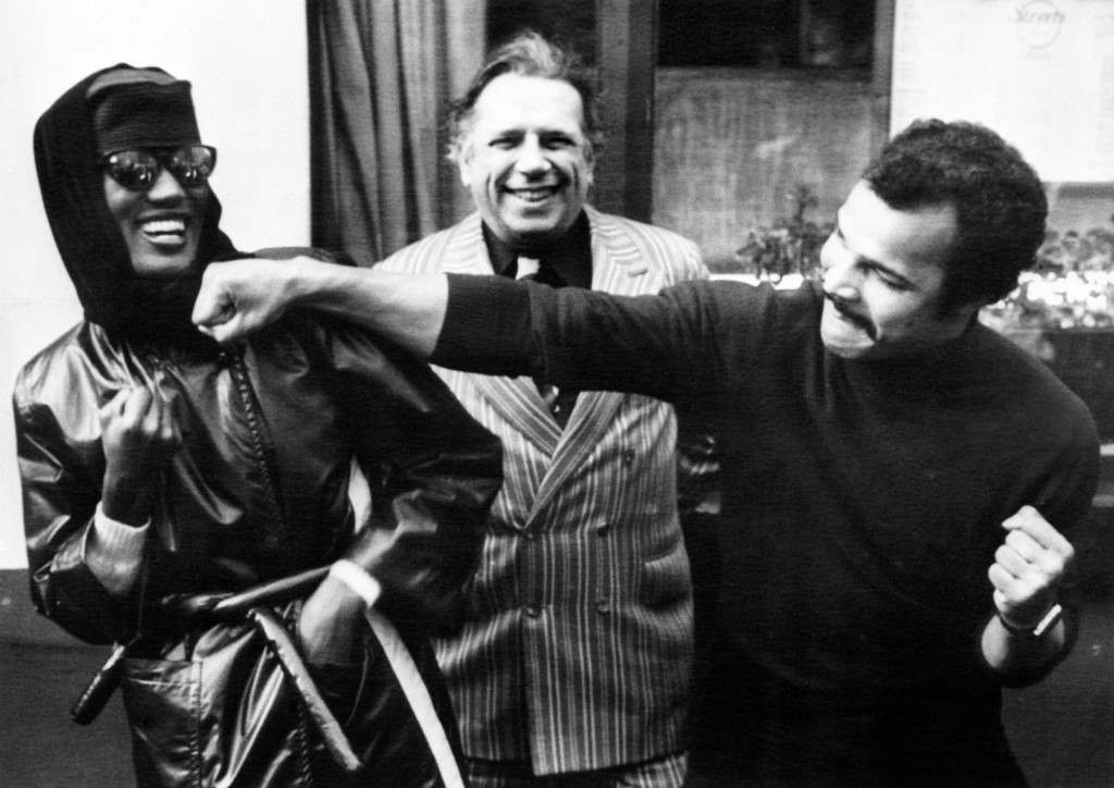 Taking it on the chin from boxer John Conteh is Grace Jones, the singer seen by millions on Russell Harty's television programme last night, with Jazz singer George melly looking on. Miss Jones' 24, claimed today that her attack on chat-show host Mr Harty was part of her act. Ref #: PA.4811574 Date: 19/11/1980