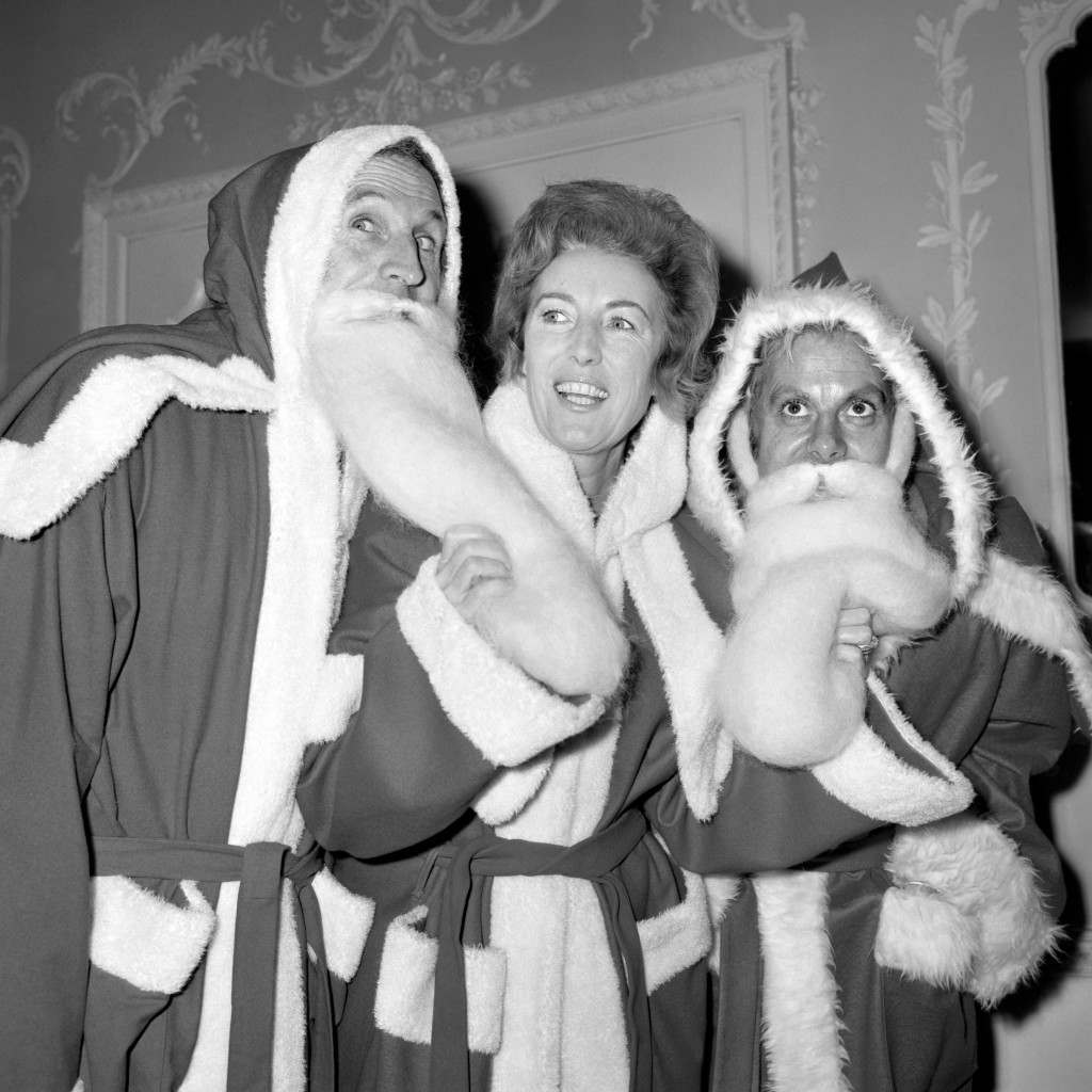 Bruce Forsyth, Vera Lynn and Danny La Rue dressed in Father Christmas outfits at the Variety Club Christmas Luncheon. Ref #: PA.5411747  Date: 07/12/1970