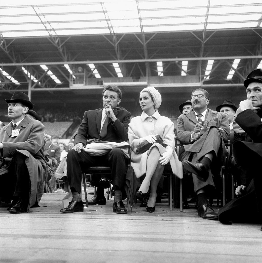 Elizabeth Taylor and Richard Burton stars of the film 'Cleopatra', at the ring side at Wembley, London for the heavy weight match between Henry Cooper and Cassius Clay. Ref #: PA.5450254