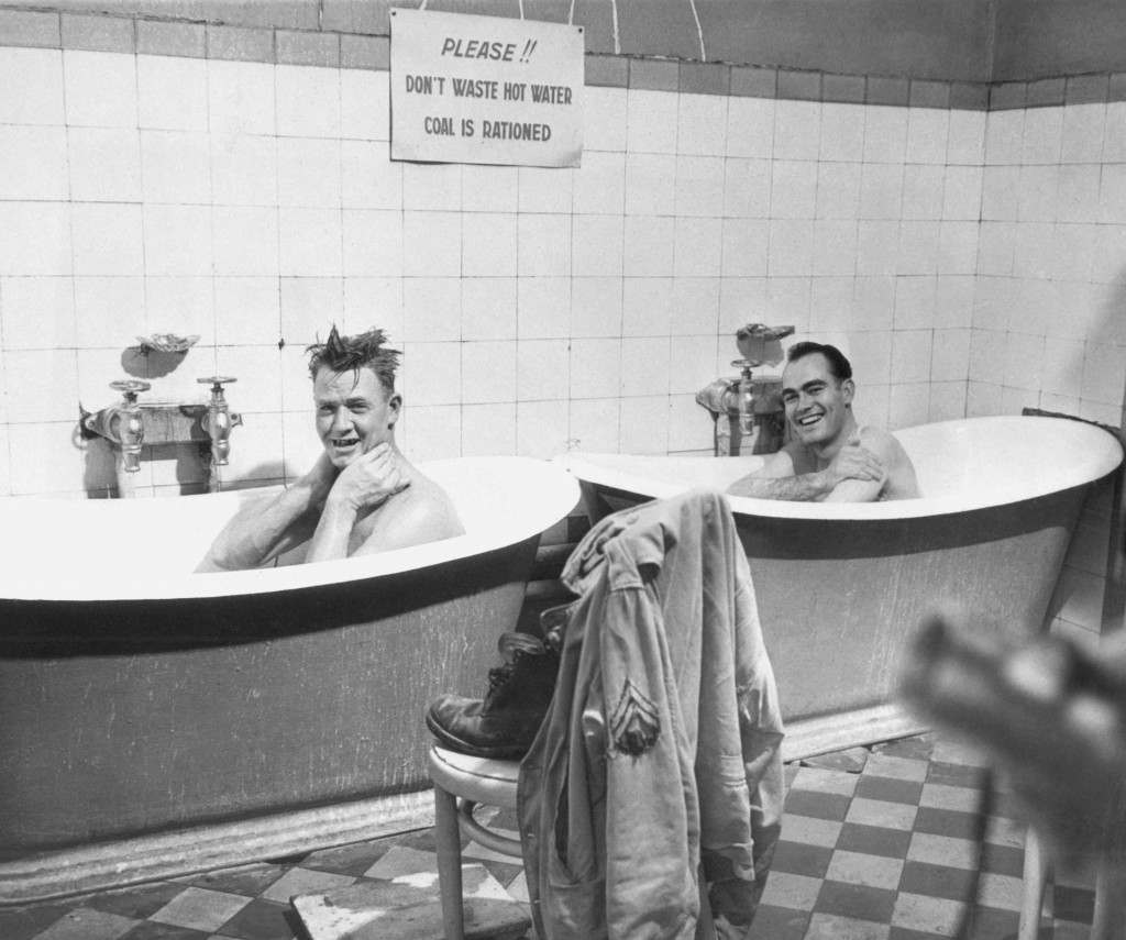 Two American soldiers enjoy the luxury of a hot bath in a French bathhouse at Dijon, now being operated by the Red Cross. From left, Cpl. Manuel Hohenberger and Cpl. George O. Clark. Ref #: PA.6711636  Date: 15/12/1944