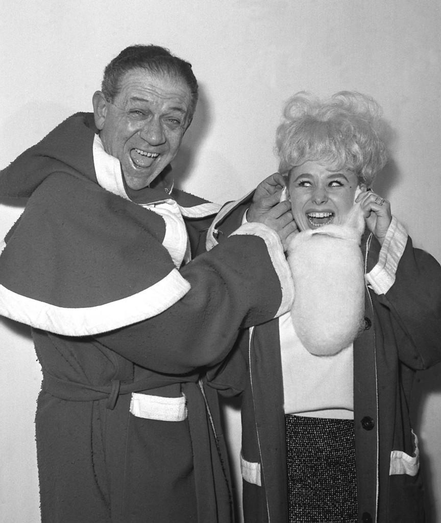 Sid James helps Barbara Windsor with her beard as the two dress up as Santa Claus for the Variety Club luncheon. Ref #: PA.729870  Date: 10/12/1963