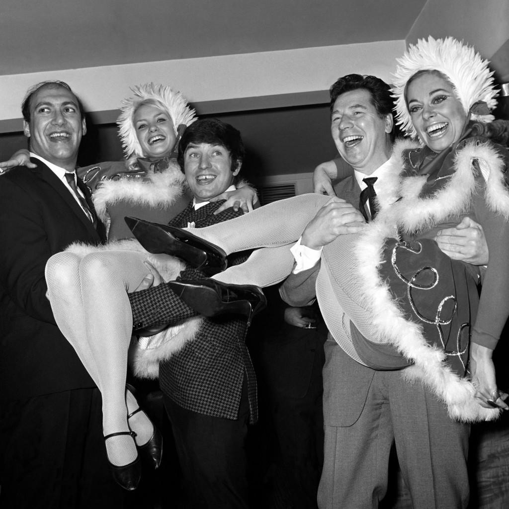 Bernard Bresslaw (l) and Jimmy Tarbuck (c) give a lift to Miss Christmas Dona Reading whilst Max Bygraves (r) holds Joan Crane. Ref #: PA.7478619  Date: 13/12/1966
