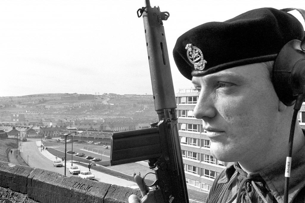 Private Edward Egan of the 1st battalion The Queens Regiment, from Uckfield, Sussex, stands guard on the city walls overlooking Bogside, the Catholic area of troubled Londonderry. Ref #: PA.7780792  Date: 08/10/1969