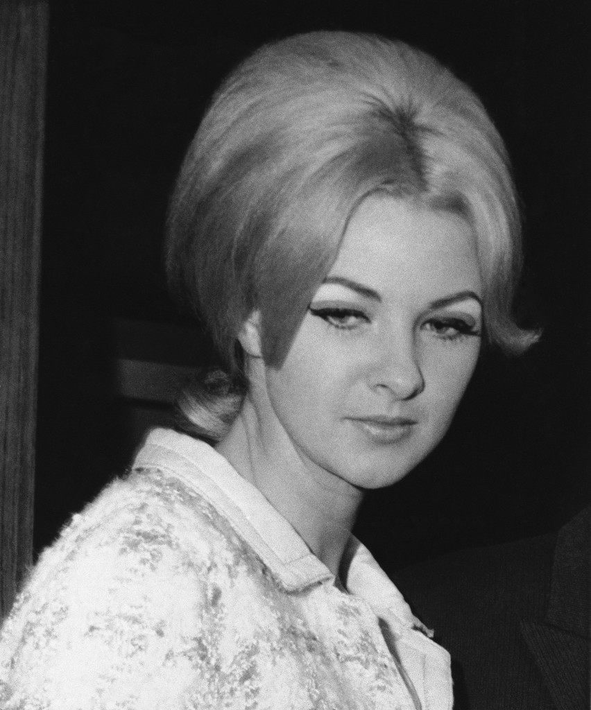 Mandy Rice Davies, 21, a prominent figure in the Profumo sex and politics scandal that rocked Britain in 1963, leaves the Marylebone Register Office in London on Sept. 17, 1966, following her marriage to 26 year old Rafael Shaul, an Israeli airline steward. Mandy is cabaret performer at the present time. She met her husband while singing at an Israeli Night Club. (AP Photo) Ref #: PA.8600586