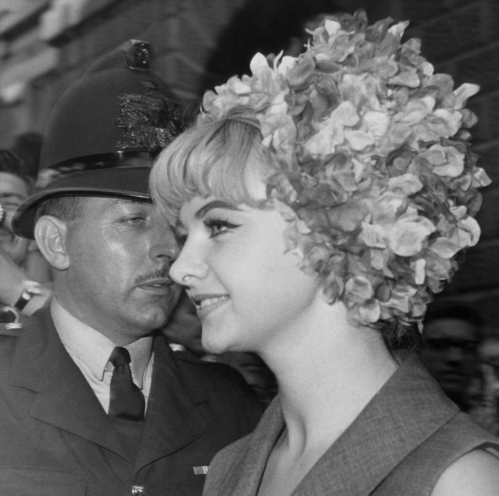 Rice-Davies, wearing a floral petal hat, pictured in London on July 23, 1963, after giving evidence during the second day?s hearing of the trial on vice charges of osteopath Dr. Stephen Ward, 50.