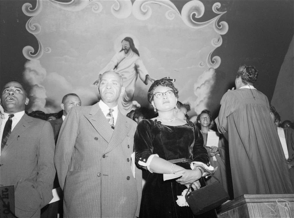 Mrs. Mamie Bradley, mother of Emmett Louis Till, a black 14 year old slain in Mississippi, attends a rally in Williams Institutional Christian Methodist Episcopal Church at Seventh Avenue, between 131st and 132nd Streets, New York City, September 25, 1955, at which the verdict of last week's trial at Sumner, MS was denounced. Mrs. Bradley told the rally that the acquittal of the two men accused of the murder of her son constituted a signal that lynching is now in order. (AP Photo/stf)