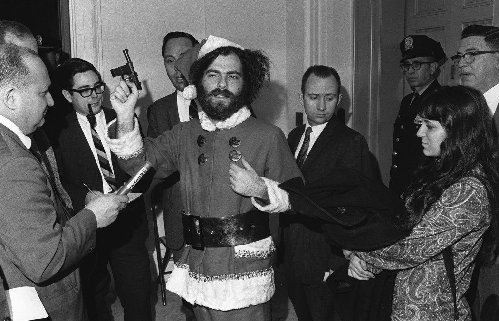 Yippie leader Jerry Rubin appears with a toy gun and Santa Claus suit on Capitol Hill during the hearing of the House Committee in Un-American Activities in Washington D.C. on Dec. 4, 1968. Rubin, who was barred from the hearing, told people that his costume was typical of the committee, which he describes as Ref #: PA.8658210