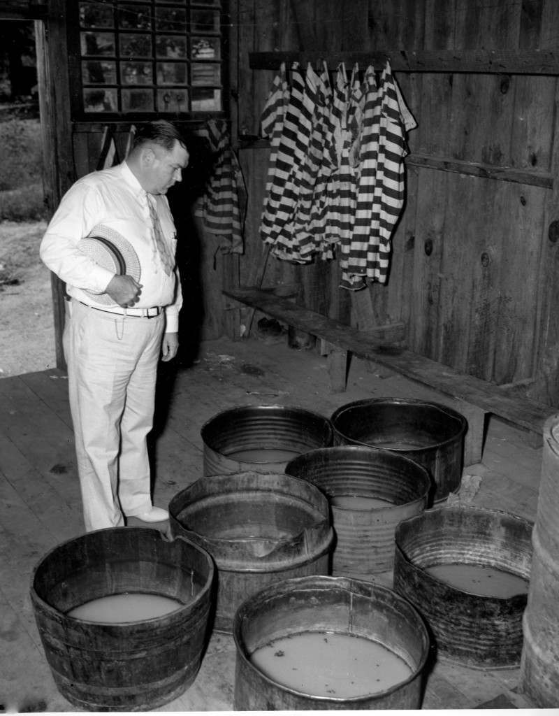 U.S. Sen. Lee S. Purdon, chairman of the State Senate Penitentiary Committee, views the tubs inside the bath house for prisoners at the Pickens County chain gang camp in Jasper, Ga., June 24, 1937. (AP Photo)
