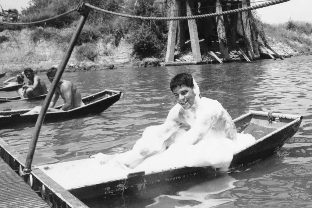"""A Pontoon supporting of foot bridge near Da nang Republic of Vietnam on April 29, 1966 serves as a bathtub for Sgt. Richard Mccloud (Aiea, Hawall) for """"G"""" Co.,2nd Bn., ninth Marine Regiment, 3rd Marine Division. The Bubble bath was sent by a girl friend. The Bridge links the company's positions. (AP Photo)"""