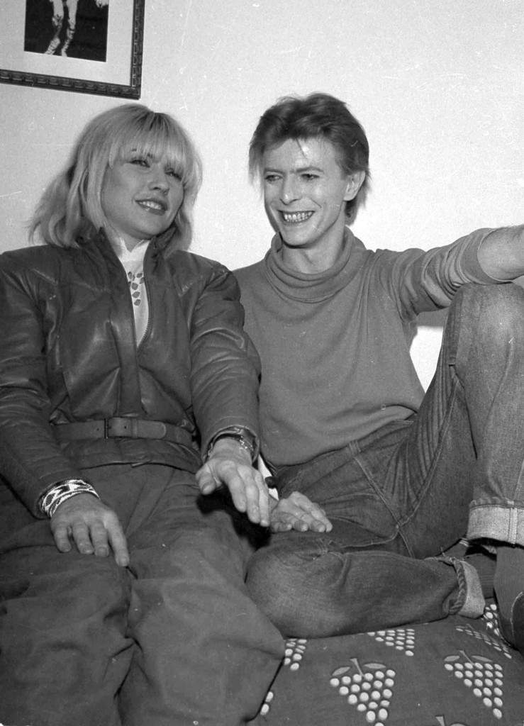 "Deborah Harry of the rock band Blondie visits David Bowie backstage at the Booth Theater where he is starring in ""The Elephant Man,"" Nov. 1980. (AP Photo/Nancy Kaye) Ref #: PA.8802797"