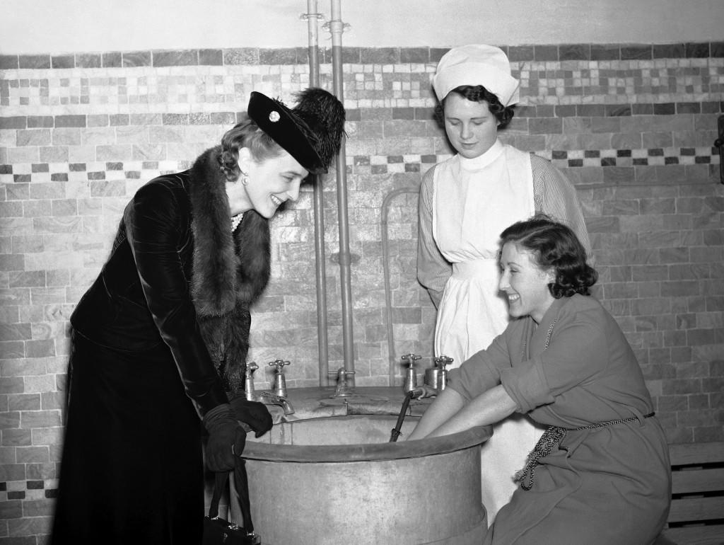 Princess Marina, the Duchess of Kent chatting to a patient as she paid a visit to the Royal National Hospital for Rheumatic Diseases in Bath, England on Oct. 19, 1938 where she received over 260 purses containing over $2000 for the hospital. Afterwards she toured the hospital and the new site which the city has given to the hospital. (AP Photo/Staff/Putnam)
