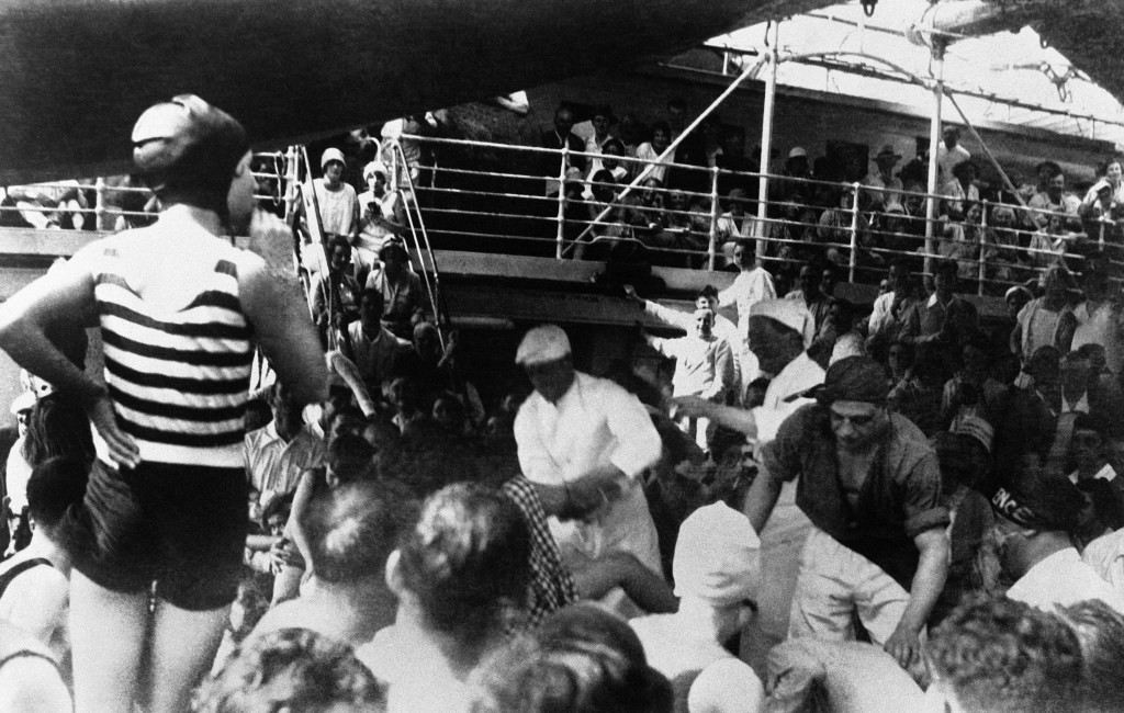 """Britain's Prince Edward, The Prince of Wales, dressed in white, """"Ducking"""" a girl in the tub as the ship """"crossed the line"""" of the Equator on board the Kenilworth Castle ship enroute to South Africa on Feb. 10, 1930. Passengers who were crossing the line for the first time were subjected to a """"ducking"""" and none enjoyed the fun more heartily than the Prince, who officiated at the tub. (AP Photo)"""