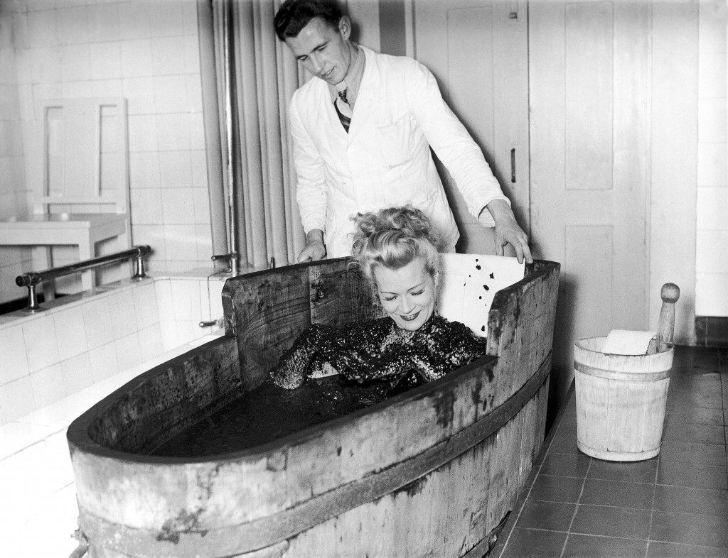 A blonde patient tries a mud bath at the sanitarium in Dachau on Dec. 23, 1948, a German town which is trying to wipe out the memory of the days when it was infamous for its concentration camp. (AP Photo)