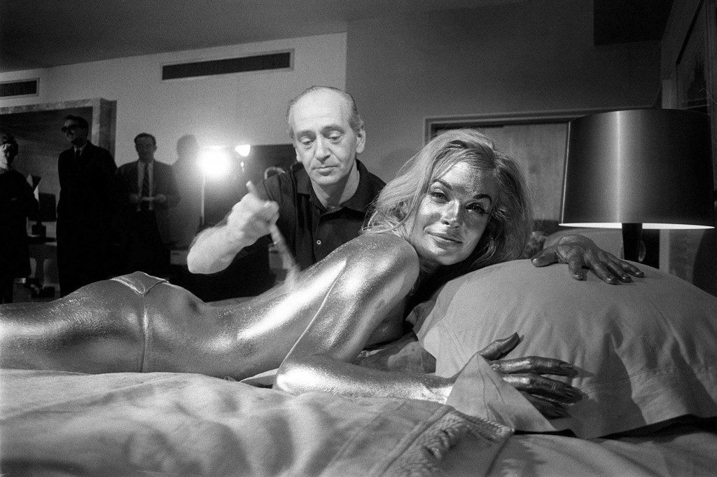 It was a hard job, but someone had to do it. Shirley Eaton being painted gold.