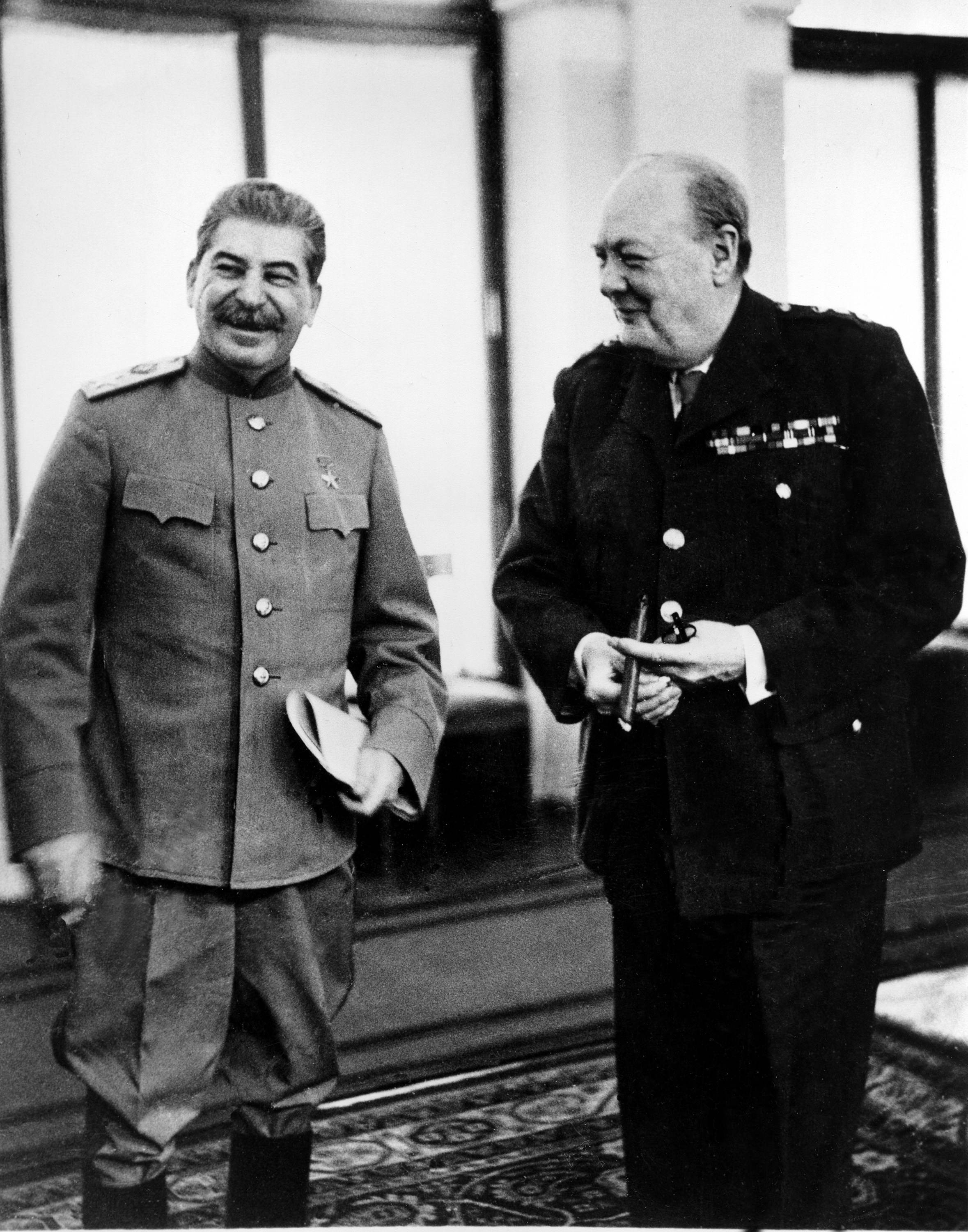 Josef Stalin, left, and British Prime Minister Winston Churchill are shown laughing in the conference room at the Lividia Palace in Yalta, in Crimea, U.S.S.R., in Feb. 1945 for the Yalta Conferenc PA-8630965