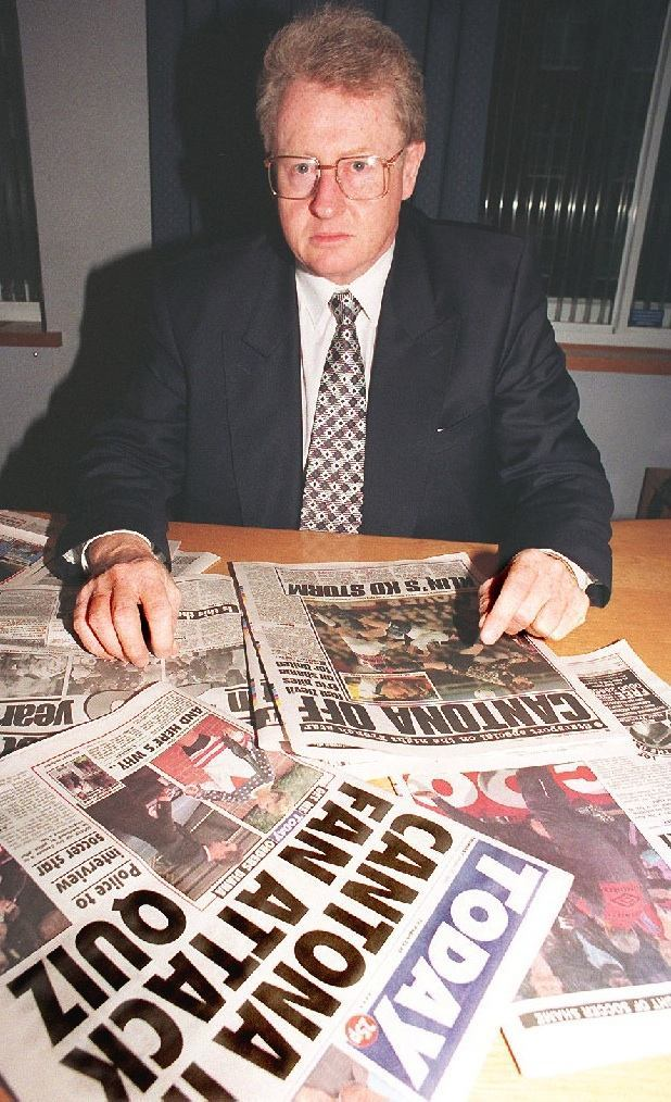 6: 26.1.95: LONDON: Graham Kelly, Chief Executive of the Football Association, surveys the papers this morning (Thursday) following last night's incident involving Eric Cantona. The Manchester United striker was sent off in the 48th minute of yesterday's Premier League match against Crystal Palace after he lunged at a supporter in the crowd.