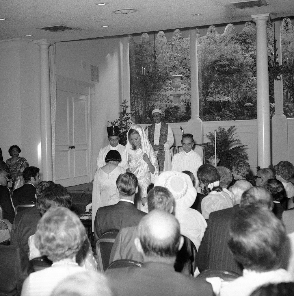 Zubin Mehta and his bride Nancy Kovack during the Zoroastrian wedding ceremony in Los Angeles on Saturday, July 20, 1969 performed by Paris high priest Dr. Framroze Areshir Bode, standing background, wearing the long, flowing white robe of his priesthood, with a white turban of 12 yards of startched white cloth. The bridegroom's mother (back to camera) kneels before the bridal couple. Mehta's father is at right, wearing black skull cap. (AP Photo)