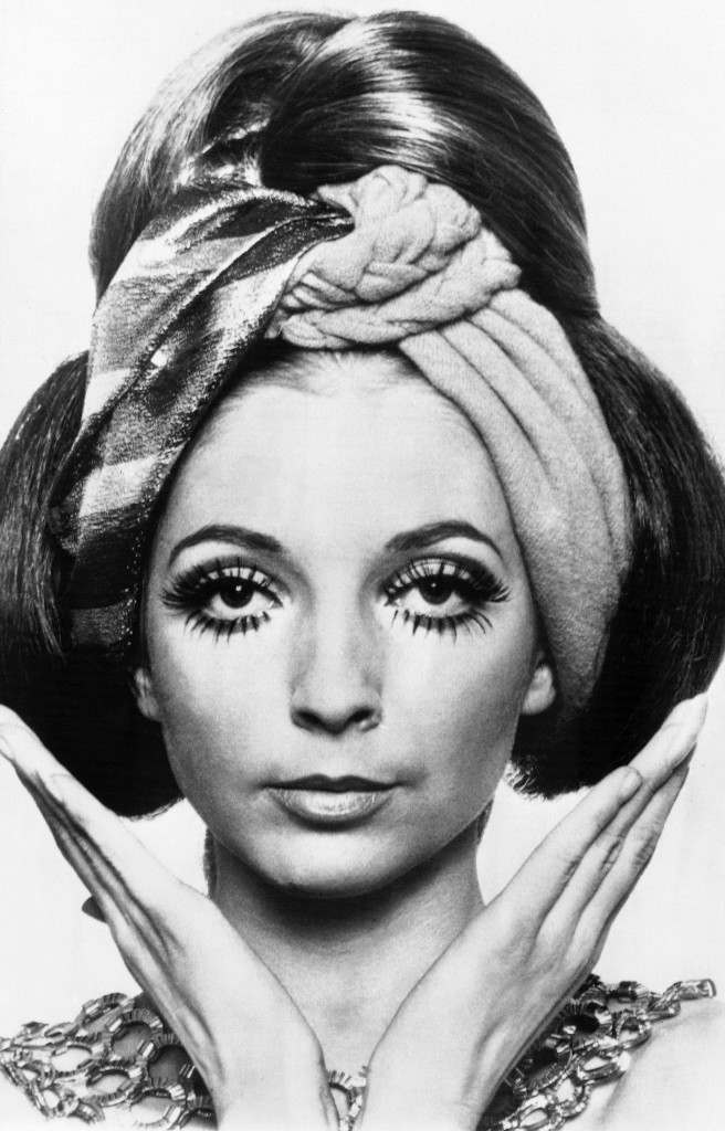 """Sultaness"" is the name of this hairdo created by stylist Claude of Charles of the Ritz for the Spring and Summer season's evening parties. The model's eyes are widened by hand-painted lashes. The style was shown in Paris on Feb. 5, 1969. (AP Photo)"